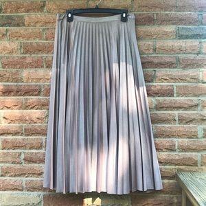 Rose gold pleated midi length skirt